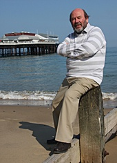 Keith Skipper, MBE, DL, Founder of FOND, near Cromer Pier.